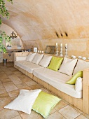 Comfortable bench in spa area with barrel vaulted ceiling