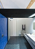 Modern bathroom with blue wall in open shower area