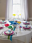 Easter Table Set with Bowls of Colored Easter Eggs