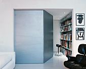 Side room of modern living room with open door and view of bookcase