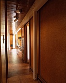 Narrow hall with wood-clad wall