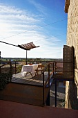 Airy terrace with set table below a blue sky