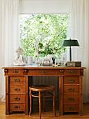 19th century oak desk and stool below window in study