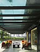 Glass-roofed terrace with lounge furniture