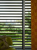 70s patterns in front of sun shade louver blinds with view of palm tree