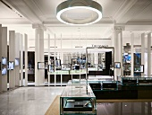 Elegant retail premises with modern display cases and lighting in traditional building with Classical columns