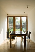 Dining table and four chairs in white dining room