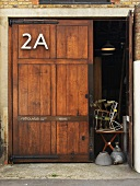 Old wooden door with house number