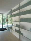 Room-height shelving with translucent glass front