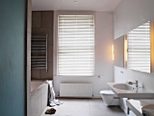 White bathroom with closed blinds