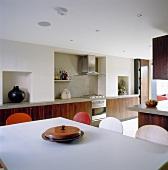 Dining area in modern, open-plan kitchen