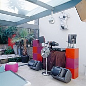 DJ equipment with colourful cubist modules in extension with terrace
