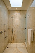 Shower room with marble tiling and skylight