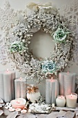Decorative winter wreath and candles