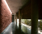 Colonnade in house with concrete walls