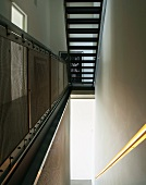 Stairwell with illuminated rail
