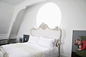 Bedroom with nostalgic double bed & portraits