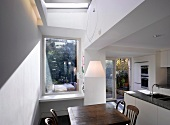 Kitchen with dining area, terrace doors & skylight