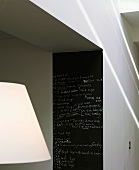 Blackboard with notes on kitchen wall