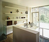 Gallery with shelving & balcony door
