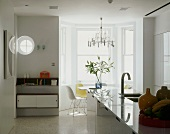 Open living space with kitchen & seating in bay window