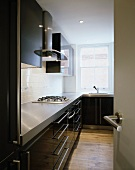 Modern kitchen with fitted cupboards and gas cooker