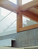 Bottom view of staircase with wooden beams
