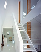 Stairwell with open stair treads & glass walls