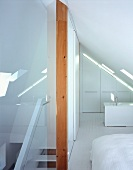 Staircase to sleeping area under sloping roof
