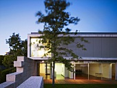 Modern house with glass wall, terrace & flat roof