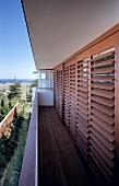 Wooden blinds on balcony windows