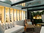 Living room with white sofas and antique couch in modern conservatory