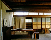 Rustic country house with wooden furniture and Japanese-style walls
