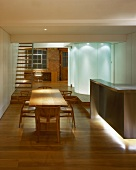 Open-plan living space with dining area and backlit, cylindrical glass installations
