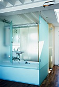 Bathroom with half-open, folding, glass bathtub partition