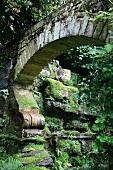 Stone grotto in garden of Hever Castle, Kent, England