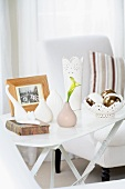 White side table with vases, ornamental dish, cat figurine and photograph