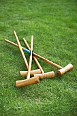 Croquet mallets on lawn
