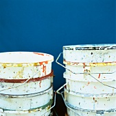 Stacked, empty paint buckets