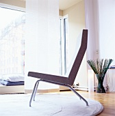 Chair on round rug in living room