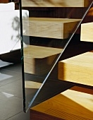 Detail of wooden stair treads and glass balustrade