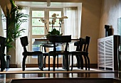 Dining area with black, antique wooden chairs