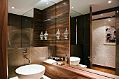 Luxurious bathroom with nut wood panelling and designer washstand
