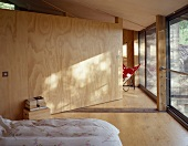 Wooden partition in contemporary bedroom
