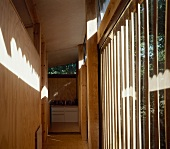 Hall with wood panelling and floor-to-ceiling windows