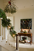 Christmas decorations on stairs in foyer of country house