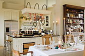 Festive set table in open-plan country house kitchen