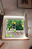 Open window with view of roof of neighbouring house