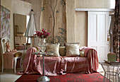 Sofa with pink throw in rustic interior