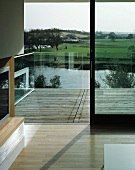 View of surrounding landscape from living room across balcony